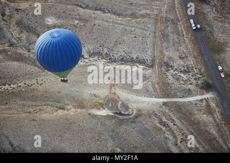 Blur hot air balloon flying over the road with motor transport. View from above - Stock Photo