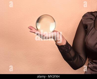 Female fortune teller holding a magic ball - Stock Photo