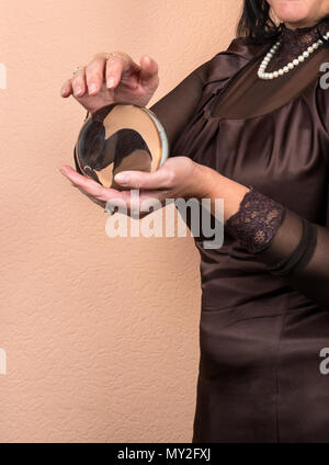 Female fortune teller holding in his hand the magic ball depends on the destiny of man - Stock Photo