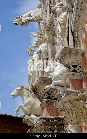 marble sculptures outside the duomo, siena, tuscany, italy - Stock Photo