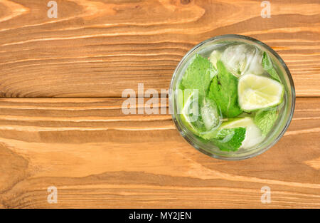 Fresh mojito cocktail in a glass on the table, top view - Stock Photo