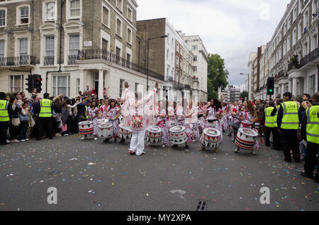 LONDON - AUG 29: Members of the Batala Band performing at Notting Hill Carnival on August 29, 2011 in London, England. The annual carnival,  the large - Stock Photo