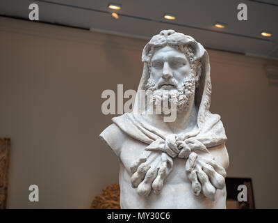 A marble statue of a bearded Hercules weating lion skin, made around 1st century A.D. in the Roman times. - Stock Photo