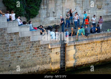 Parisians along River Seine celebrate Fête de la Musique - annual city-wide music festival each June 21st, Paris, France - Stock Photo