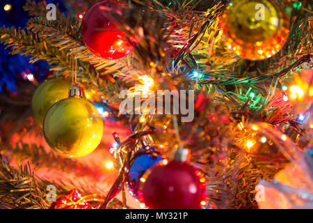 Decorated Christmas tree on blurred,  Beautiful Christmas ball hanging decorated christmas tree background. - Stock Photo