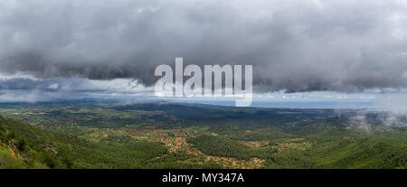 Mallorca, XXL panorama dark rainy clouds in the sky over green mountainous landscape on coastline of the island - Stock Photo