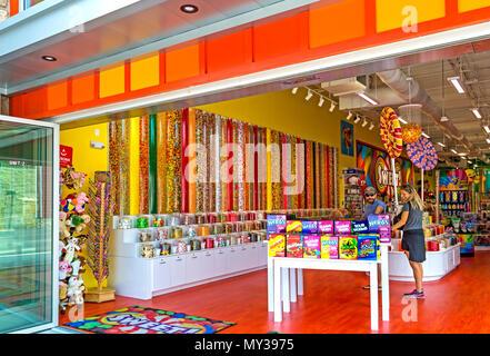Gatlinburg,TN, USA – May 14, 2018: A young tourist couple enjoying the Sweet Candy Shop on the Gatlinburg Strip. - Stock Photo