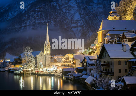 Hallstat village in the Austria at the evening time. Beautiful village in the mountain valley near lake - Stock Photo