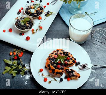 Healthy vegan banana blueberry muffins with fresh berries - Stock Photo
