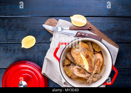 a cast-iron pan and a golden chicken from the oven. Delicious family dinner. Top view, space for text. copy space. flat lay - Stock Photo