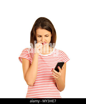 Portrait of teenage girl thinking seriously while holding a cellphone. emotional girl isolated on white background. - Stock Photo