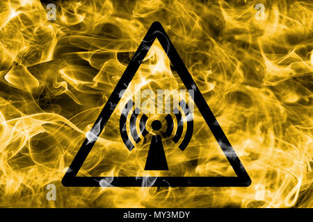 Non ionizing electromagnetic radiation hazard warning smoke sign. Triangular warning hazard sign, smoke background. - Stock Photo