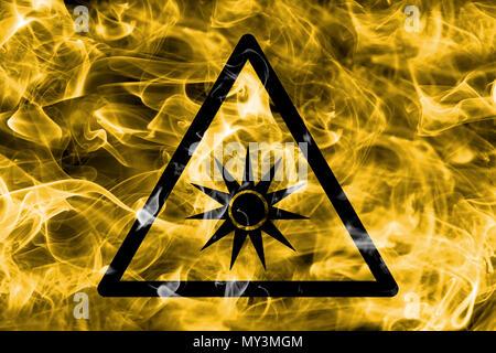 Optical radiation hazard warning smoke sign. Triangular warning hazard sign, smoke background. - Stock Photo
