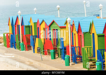 Colorful beach huts in a row on the white sandy Beach of Muizenberg under a blue summer sky. Muizenberg, Cape Town, South Africa. - Stock Photo