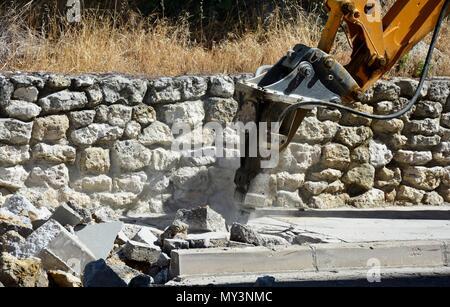 digger, digging, pneumatic drill, jackhammer, pavement, sidewalk - Stock Photo