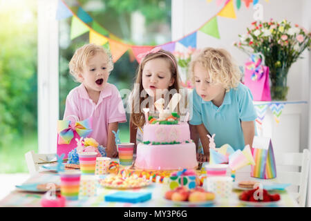 Kids Birthday Party Children Blow Out Candles On Pink Bunny Cake Pastel Rainbow Decoration