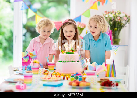 Table With Decoration Kids Birthday Party Children Blow Out Candles On Pink Bunny Cake Pastel Rainbow