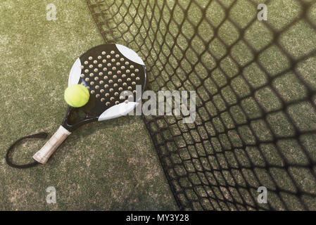 Paddle tennis objects on turf ready for tournament - Stock Photo
