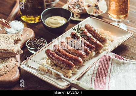 Traditional German Grilled Sausages with Cabbage Salad, Mustard and Beer - Stock Photo