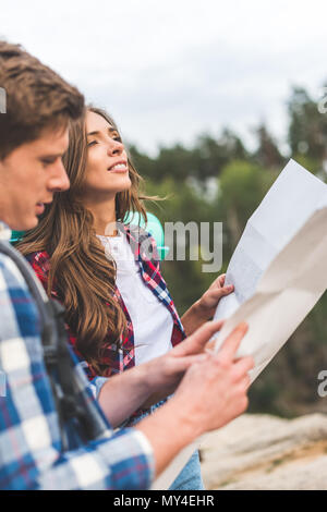 happy active couple on hiking trip with map - Stock Photo