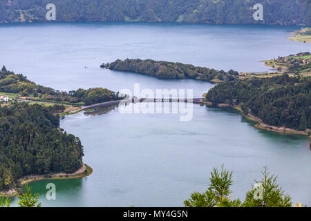 Bridge over the Lake of Sete Cidades ('Seven Cities Lake'), a volcanic crater lake on Sao Miguel island, Azores (Açores), Portugal. View from Vista do - Stock Photo