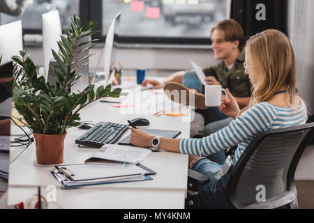 young colleagues working at modern office