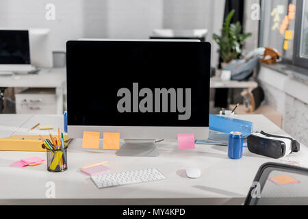 modern computer with blank screen at workplace in office - Stock Photo