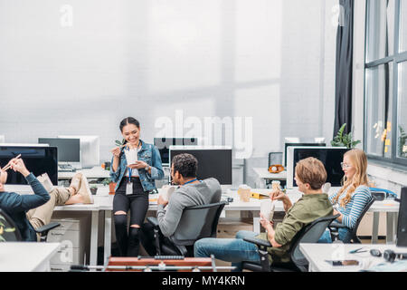 multicultural people eating thai food at modern office - Stock Photo