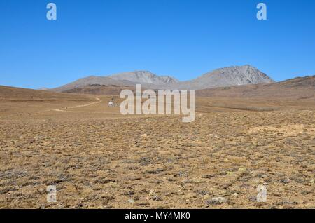 Scientific equipment by deserted and empty road in dry and barren Deosai Plains Gilgit-Baltistan Pakistan - Stock Photo