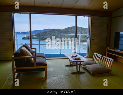 Sea view wooden bedroom of traditional Japanese hotel. - Stock Photo
