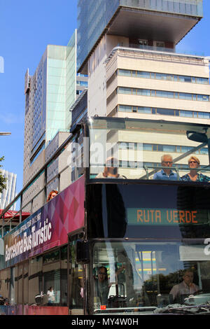 City tour bus with tourist passengers in Poblenou, Barcelona, Catalonia, Spain - Stock Photo