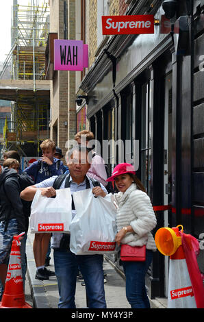 London, UK, 05 June 2018, Queue at cult skateboard clothing shop Supreme in Peter street in the heart of  Soho. - Stock Photo