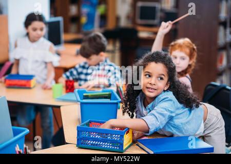 beautiful little kids in school library