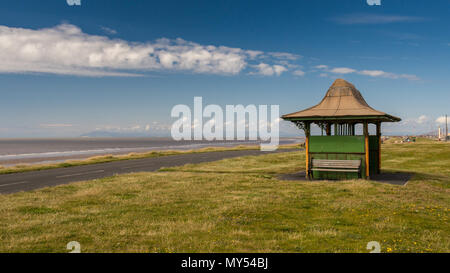 A traditional Victorian shelter on Queen's Promenade, on Bispham Cliffs, in the north of Blackpool, England, with the Irish Sea behind. - Stock Photo