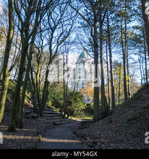Lancaster, England, UK - November 12, 2017: The Baroque architecture of the Ashton Memorial building is visible through the trees of Williamson Park. - Stock Photo