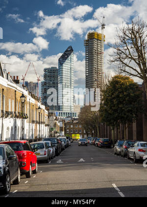London, England, UK - February 12, 2018: A cluster of new high rise apartment buildings stands with construction partially completed on City Road, wit - Stock Photo