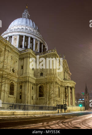 London, England, UK - February 28, 2018: Snow falls on St Paul's Cathedral during the 'beast from the east' storm in London. - Stock Photo