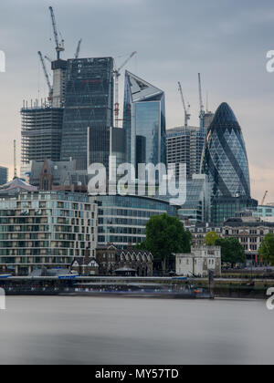 London, England, UK - June 1, 2018: Skyscrapers are surrounded by cranes during a construction boom in the City of London. - Stock Photo