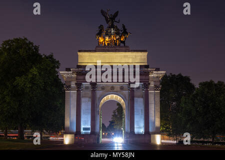 London, England, UK - June 1, 2018: The triumphal Wellington Arch at the head of Constitution Hill on Hyde Park Corner in London is lit up at night. - Stock Photo