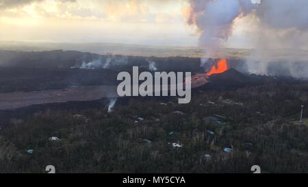 A massive lava fountain spewing magma 160 feet into the air from fissure 8 at the corner of Nohea and Leilani caused by the eruption of the Kilauea volcano June 4, 2018 in Hawaii. The recent eruption continues destroying homes, forcing evacuations and spewing lava and poison gas on the Big Island of Hawaii. - Stock Photo