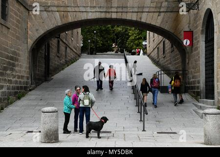 Madrid, Spain. 5th June, 2018. People talk by the side of a road at El Escorial, Spain, on June 5, 2018. Credit: Guo Qiuda/Xinhua/Alamy Live News - Stock Photo