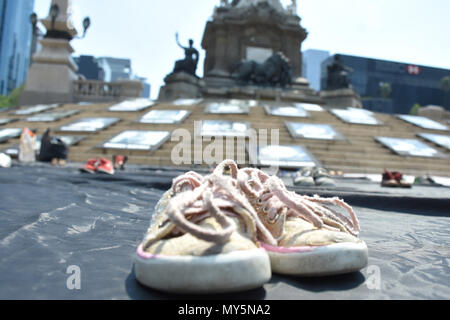 Mexico City, Mexico. 5th June, 2018. Shoes of the deceased kids are seen displayed during the 9th anniversary protest. Demonstration to the impunity and corruption of the Government during the 9 years after the tragedy on 05, June 2009. 25 little girls and 24 little boys died as a result of a fire in the ABC Nursery in Hermosillo, Sonora. Eduardo Bours was the governor. Credit: Carlos Tischler/SOPA Images/ZUMA Wire/Alamy Live News - Stock Photo
