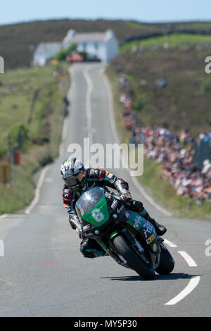 Michael Dunlop in his final winning lap past Kate's Cottage in the Lightweight TT   4th June 2018 , TT Grandstand, Isle of Man, UK; TT Raceday, - Stock Photo