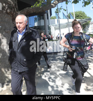 Dublin, Ireland. 6th June. 2018. David Drumm found guilty. The media scramble to get images of David Drumm as he is pictured leaving court in Dublin today. The former Anglo Irish chief was found guilty on two counts of fraud, and has been remanded on bail until June 20th for sentencing. Photo: Leah Farrell/RollingNews/Alamy Live News - Stock Photo