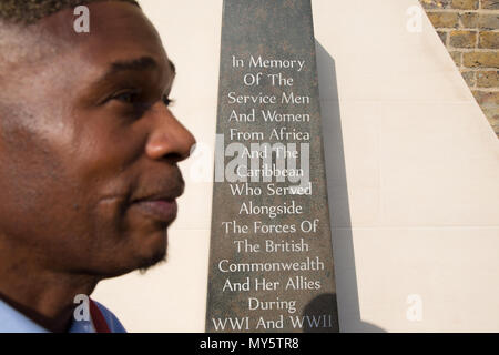 London Uk 6th June 2018 Jak Beula in front of the The African and Caribbean War Memorial in Brixton during D Day Commemoration at The Black Cultural Archives in Brixton. Credit: Thabo Jaiyesimi/Alamy Live News - Stock Photo