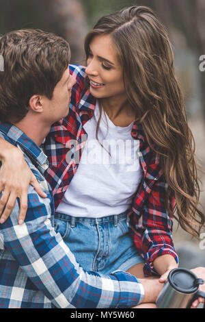 young happy couple spending time on nature - Stock Photo