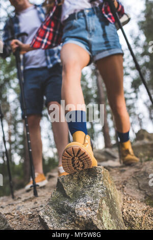 close-up shot of couple on hiking trip - Stock Photo
