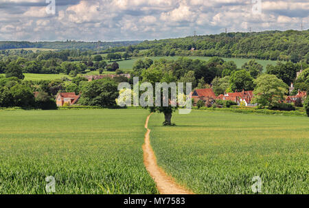 An English Rural Landscape with track through a field in the Chiltern Hills leading to the Village of Little Missenden - Stock Photo