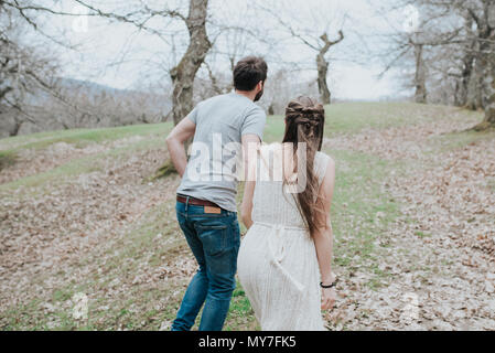 Couple walking in park - Stock Photo