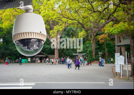 CCTV Camera or surveillance operating in outdoor park with people in japan - Stock Photo
